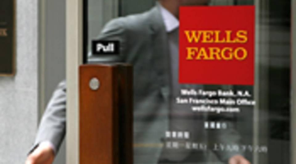 A Wells Fargo customer enters a bank branch in San Francisco, Calif.