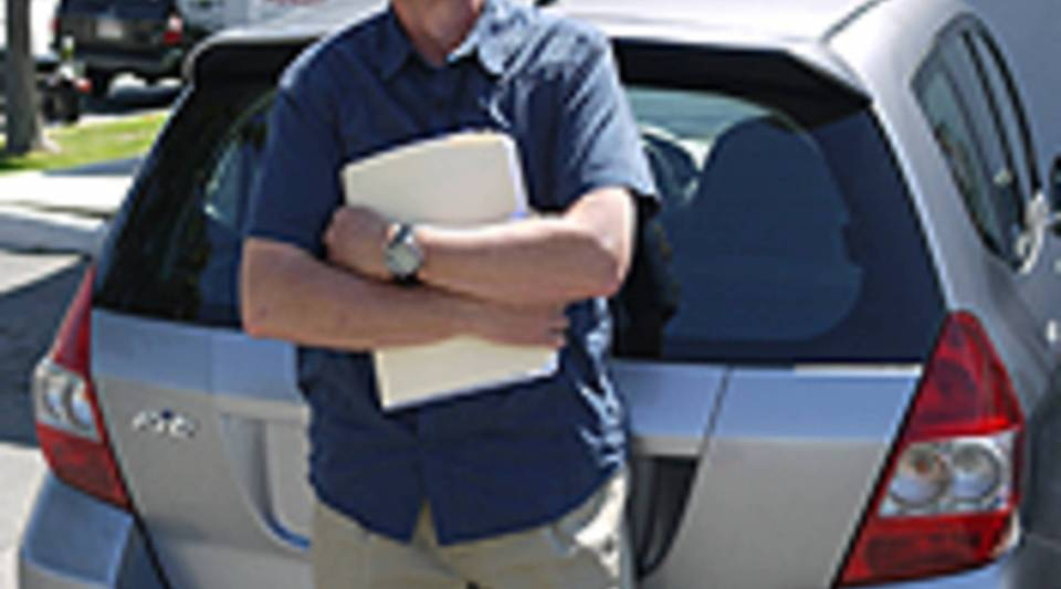 Phil Reed of Edmunds.com with his Honda Fit.