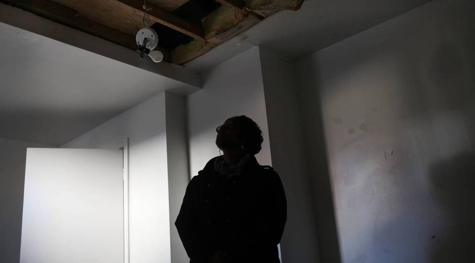 A woman, on a foreclosure tour, looks at a foreclosed home on November 21, 2010 in Derby, Conn.