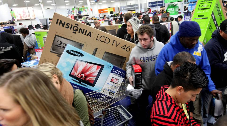 Customers shop for electronics items during Black Friday at a Best Buy store in San Diego, Calif.