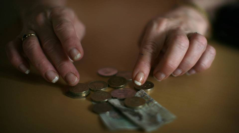 In this photo illustration, an old age pensioner checks what is left of her weekly state pension on Nov. 6, 2008, in Conwy, Wales.