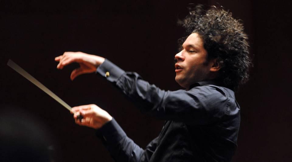 "Gustavo Dudamel conducts during the presentation of the 'Concierto Sinfonico Binacional' at the Teatro Mayor Julio Mario Santo Domingo's theatre in Bogota, on Dec. 15, 2010. Dudamel will be appearing on ""Sesame Street."""