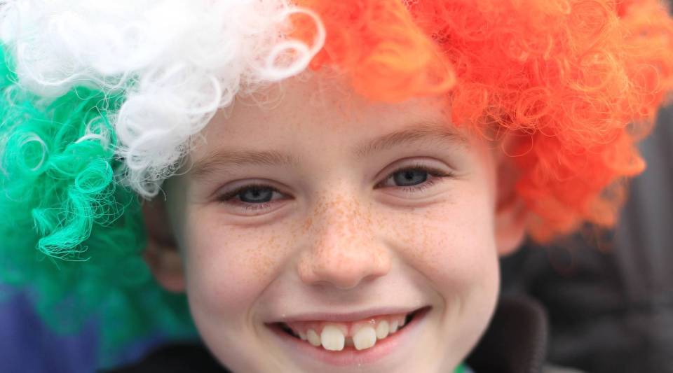 A young boy smiles in Dublin, Ireland on March 17, 2012. A new study by the U.N. took happiness of countries into account for the first time.