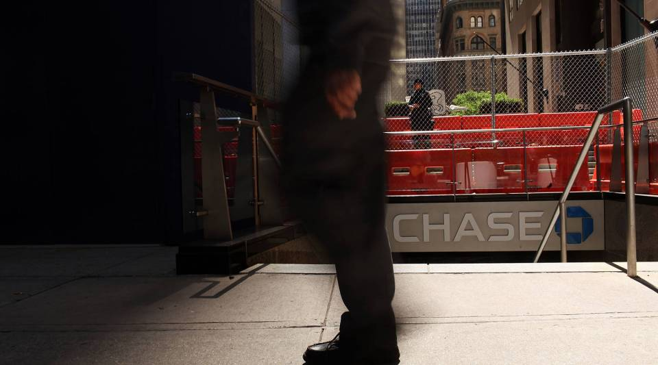 A man walks by a Chase bank branch at the company's New York headquarters in New York City.