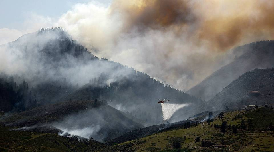 As wildfires rage across Colorado, state officials are being cautious in how they describe the conflagration, hoping not to scare away its major tourism industry like it did in 2002.