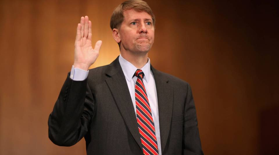 Richard Cordray, seen here swearing in at the beginning of his confirmation hearing in Sept. 2011, as director of the CFPB.