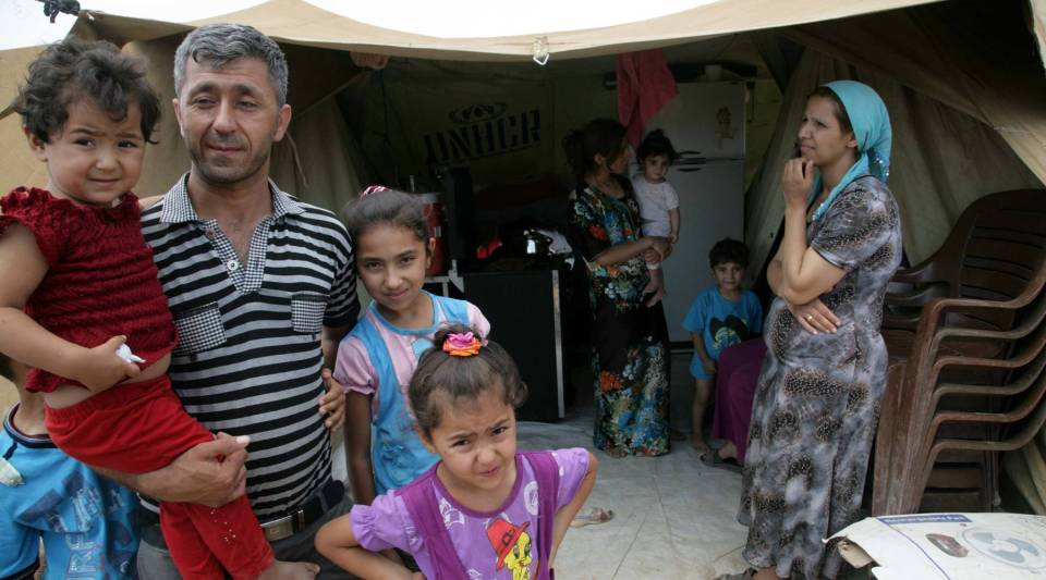 Syrian-Kurdish refugees are seen in the Domiz refugee camp, southeast of Dohuk, in northern Iraq.