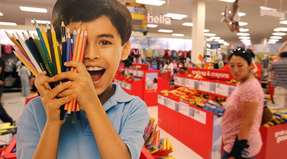 A customer shops for back to school supplies at a Target store.