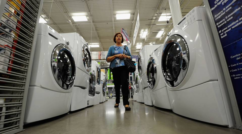 A customer shops for washers and dryers at Lowe's in Burbank, Calif.