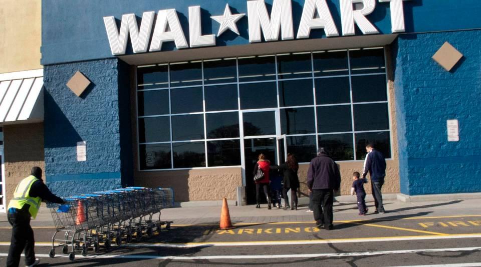 Customers walk outside a Walmart store on November 17, 2012 in Norwalk, Connecticut.