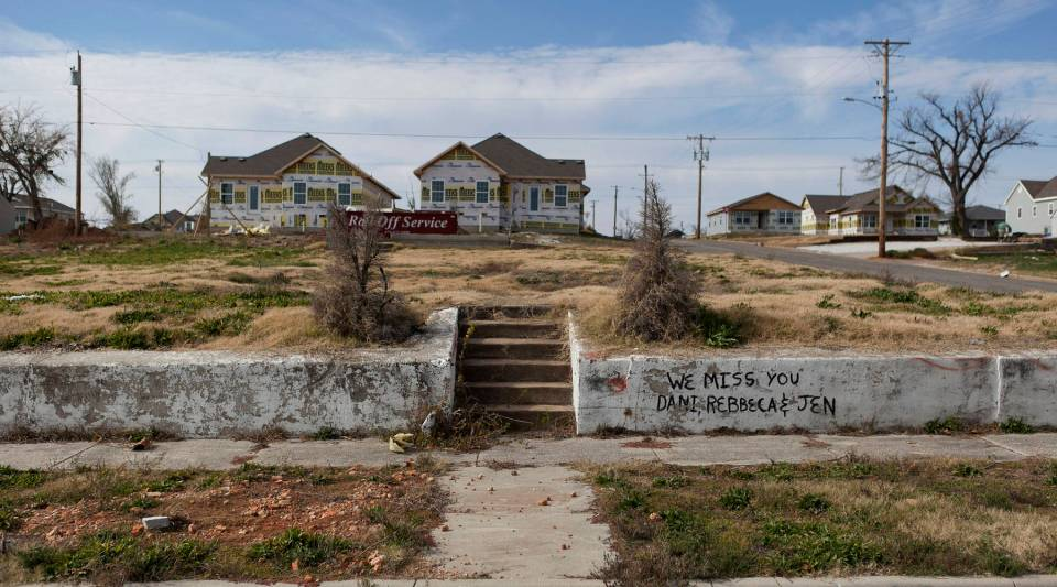 Stairs lead to an empty lot where a home once stood on South Joplin Avenue before the Joplin tornado in 2011.  Newly constructed homes can be seen in the background.