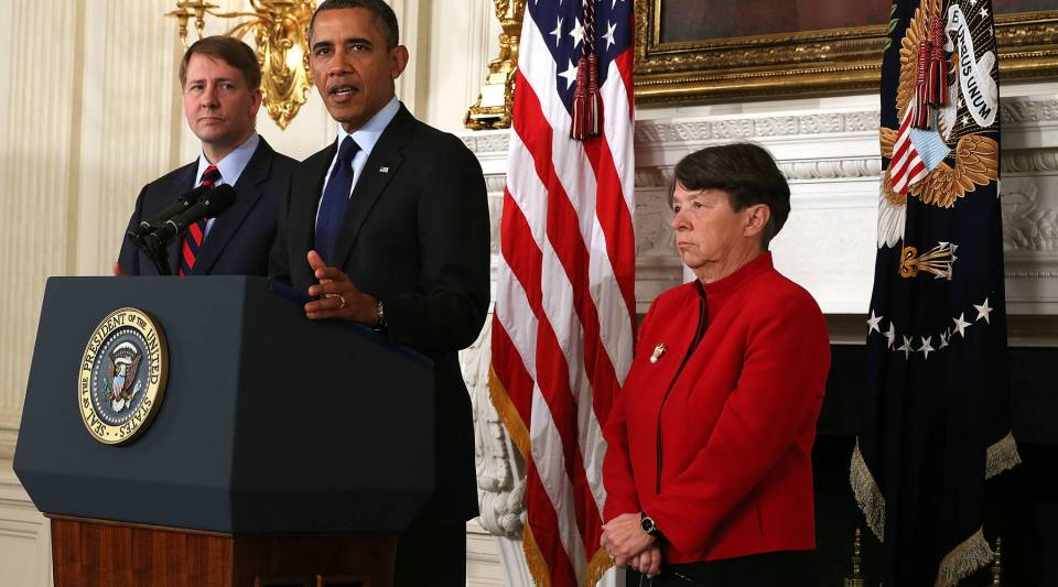 Flanked by Director of the United States Consumer Financial Protection Bureau Richard Cordray (L) and former U.S. Attorney for the Southern District of New York Mary Jo White (R) , U.S. President Barack Obama makes a personnel announcement at the State Dining Room of the White House January 24, 2013 in Washington, DC. President Obama nominated Mary Jo White to become the new chairman of Securities and Exchange Commission. He also re-nominated Richard Cordray for the same position Cordray has been holding.