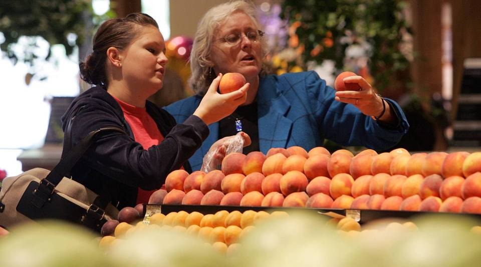Safeway customers shop for peaches in Livermore, Calif.