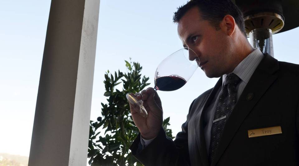 Montage Laguna Beach's Troy Smith samples wine at the hotel's Studio restaurant.