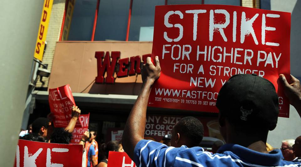 Employees and supporters demonstrate outside of a Wendy's fast-food restaurant to demand higher pay and the right to form a union on July 29, 2013 in New York City.