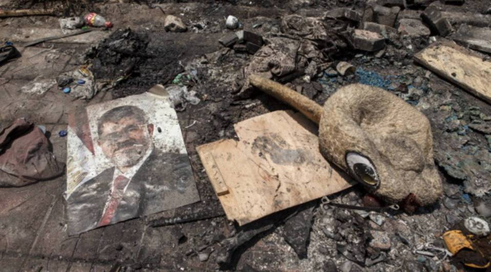 A poster of deposed Egyptian President Mohammed Morsi lies in the debris left outside the Rabaa al-Adaweya Mosque in Nasr City on August 15, 2013 in Cairo, Egypt.