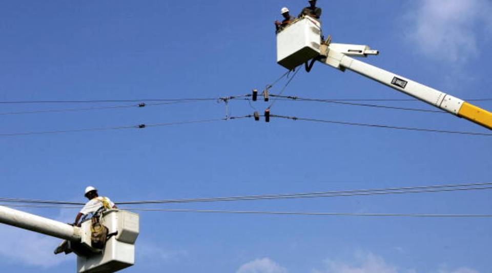 Utility workers repair a power line in New Orleans, Louisiana.
