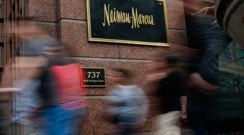 Pedestrians walk past a Neiman Marcus store on the Magnificent Mile March 5, 2009 in Chicago, Ill.