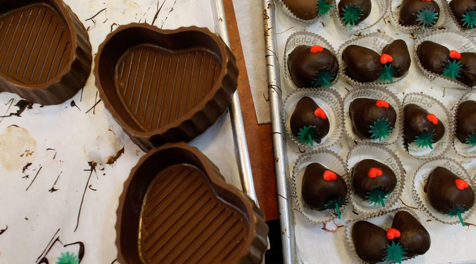 Chocolate dipped strawberries and heart shapped chocolate boxes are ready to be purchased at Schakolad Chocolate Factory on February 13, 2009 in Davie, Florida.
