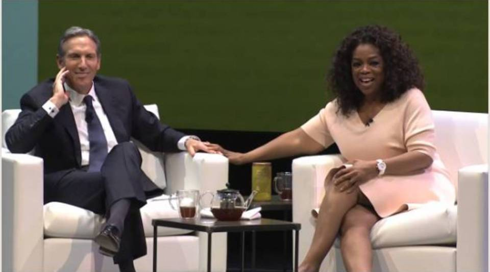 Oprah and Starbucks CEO Howard Schulz announcing their partnership.