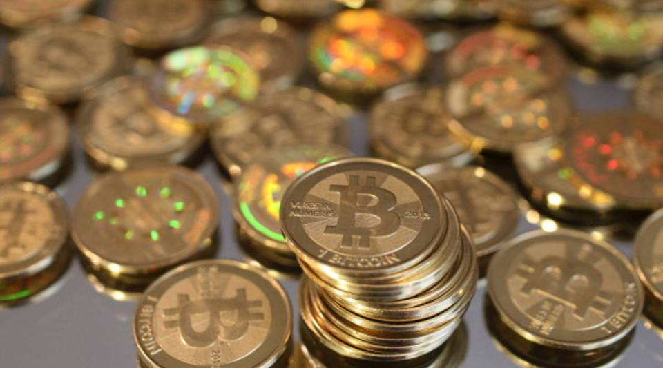 A pile of Bitcoins are shown here after Software engineer Mike Caldwell minted them in his shop on April 26, 2013 in Sandy, Utah.