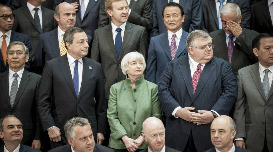 Federal Reserve Chair, Janet Yellen, look on as the group of 20 nations, finance ministers and central bankers prepare for the International Monetary and Financial Committee family photo at the IMF/World Bank Spring meetings in Washington, DC.