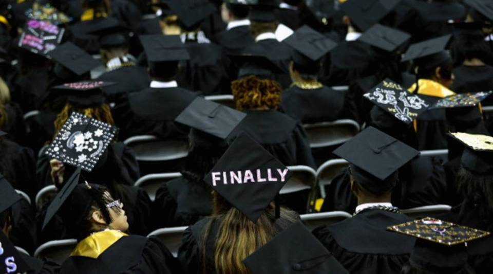 Graduates of Bowie State University put messages on their mortarboard hats during the school's graduation ceremony.
