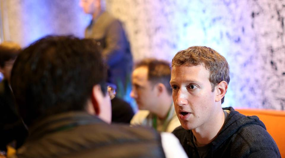 Facebook CEO Mark Zuckerberg speaks with a reporter during a 2013 event at Facebook headquarters.