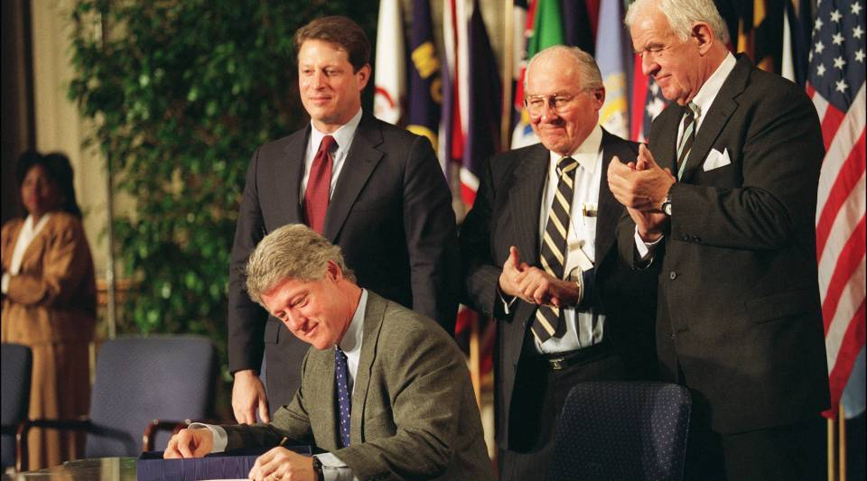 Then-U.S. President Bill Clinton signs the North American Free Trade Agreement (NAFTA) in December 1993.