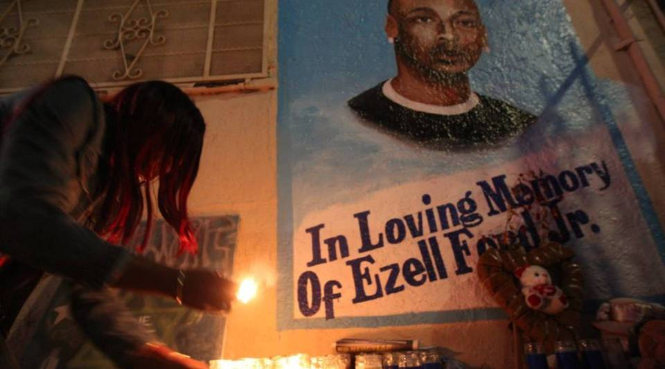 Tritobia Ford lights candles at a memorial for her son, Ezell Ford, a 25-year-old mentally ill black man, at the site where he was shot and killed by two LAPD officers in August, on December 29, 2014 in Los Angeles, California.