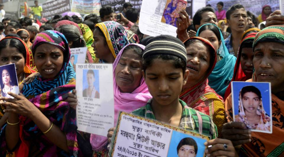 Bangladeshi relatives of missing garment workers take part in a protest marking the first anniversary of the Rana Plaza building collapse in Dhaka, Bangladesh, on April 24, 2014. More than 1,100 people were killed in the country's worst industrial disaster.