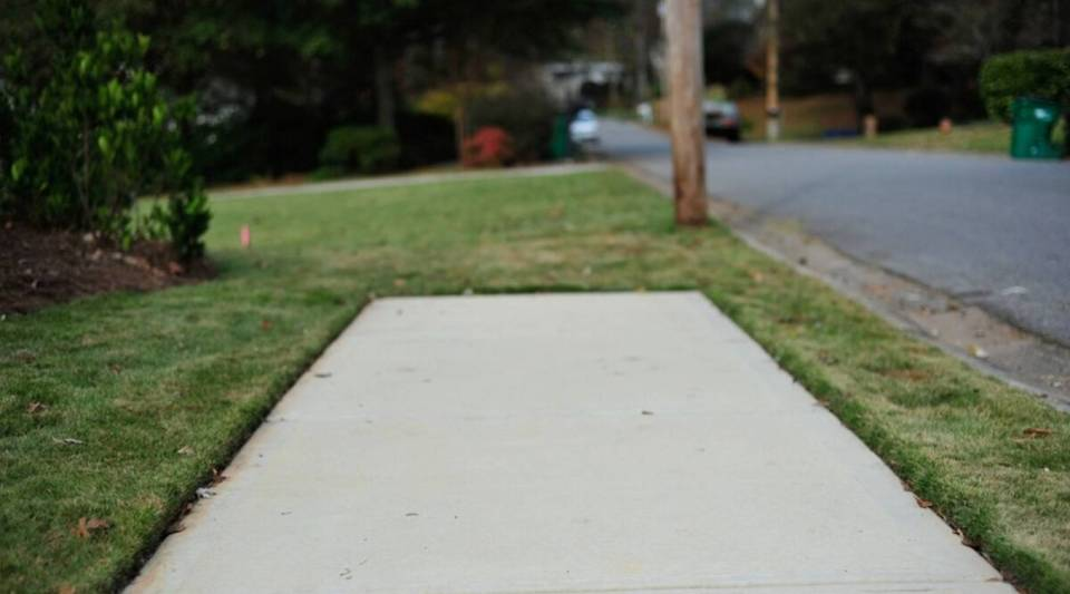 "One approach to building sidewalks that the city of Sandy Springs tried resulted in what some people called ""sidewalks to nowhere."""