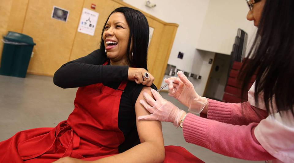 Cynthia Foreman receives a free flu shot from a Walgreens employee during a free flu shot clinic at Allen Temple Baptist Church in Oakland, California. Residents received no cost flu shots during a flu shot clinic at Allen Temple Baptist Church.
