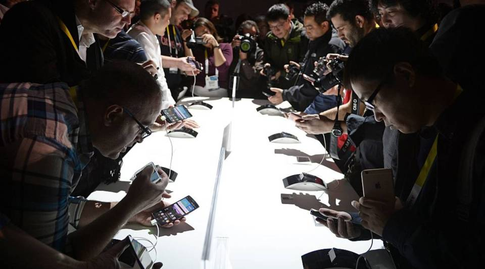 Attends get their first hands-on look at the new LG G Flex2 smart phone, at the LG press conference at 2015 Consumer Electronics Show in Las Vegas Nevada January 5, 2015.