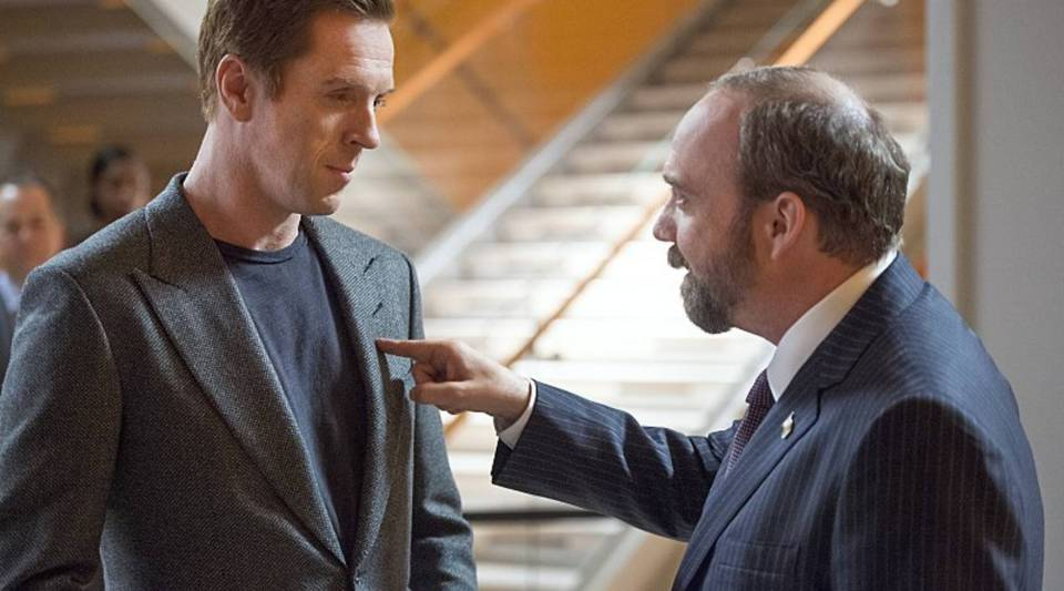 "Damian Lewis (left) and Paul Giamatti (right) square up in Showtime's new series ""Billions."""