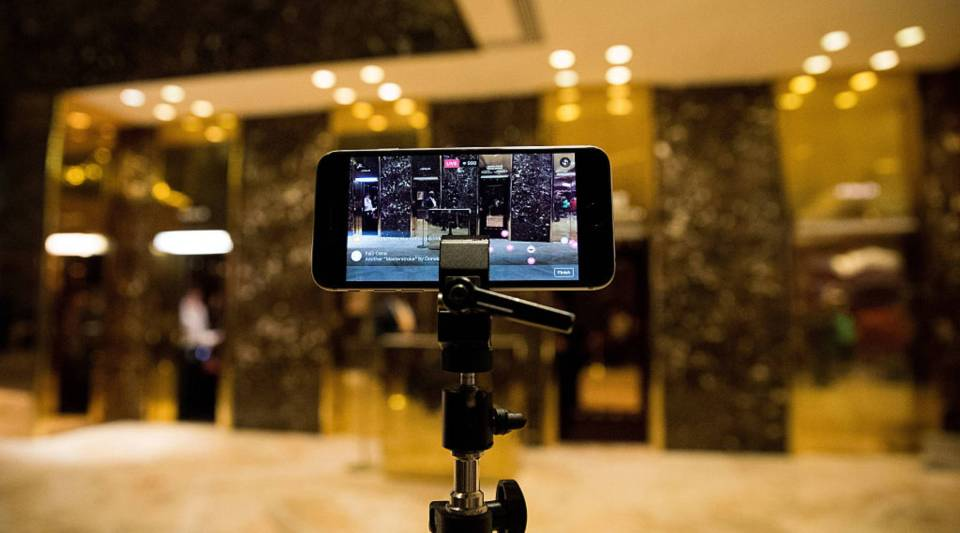 An iPhone streams a 'Facebook Live' live feed of the lobby at Trump Tower, November 29, 2016 in New York City. President-elect Donald Trump and his transition team are in the process of filling cabinet and other high level positions for the new administration. (