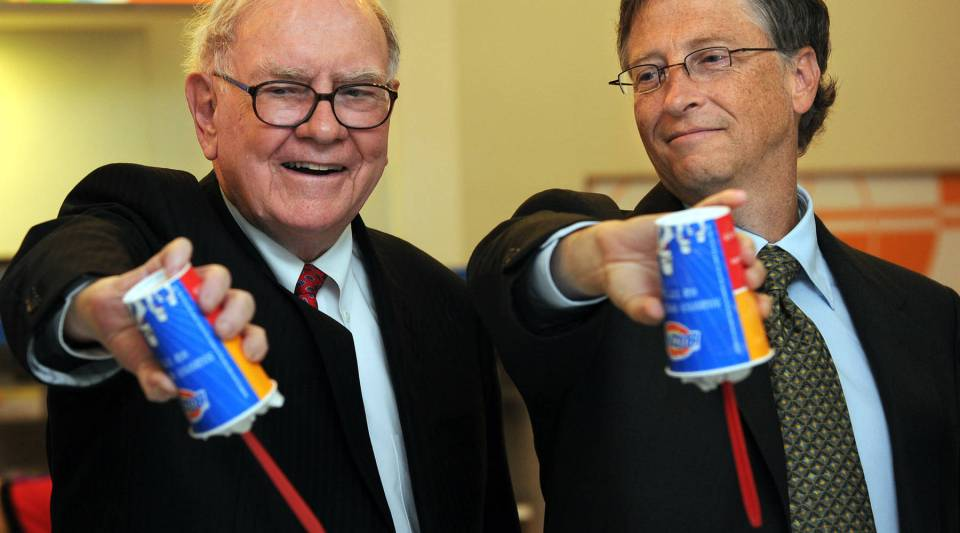 "Billionaire investor Warren Buffett and Microsoft founder Bill Gates at the opening of a new ""Dairy Queen"" branch in Beijing in 2010."