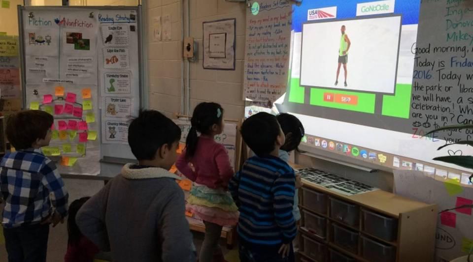 AltSchool preschoolers exercising.