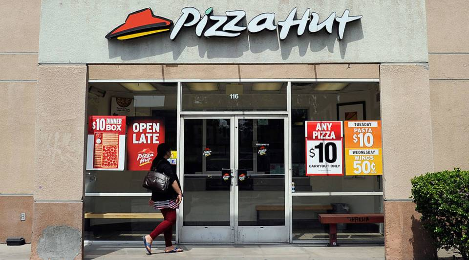A customer walks in to a Pizza Hut restaurant during lunchtime on April 19, 2012 in Los Angeles, California.