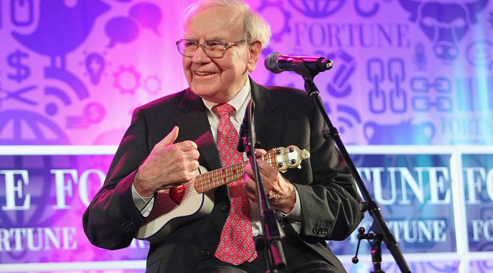 Warren Buffett performs onstage at FORTUNE Most Powerful Women Summit on October 15, 2013 in Washington, DC. His letter to investors released over the weekend had a positive outlook on the American economy.