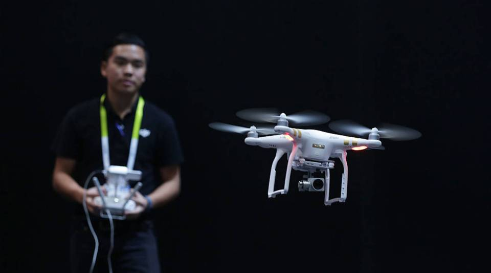 A DJI employee demonstrates flying a drone at CES 2016 at the Las Vegas Convention Center on January 7, 2016 in Las Vegas, Nevada.