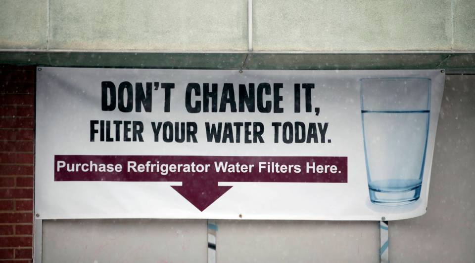 A sign on a the front of a building warns residents to filter their water in Flint, Michigan.