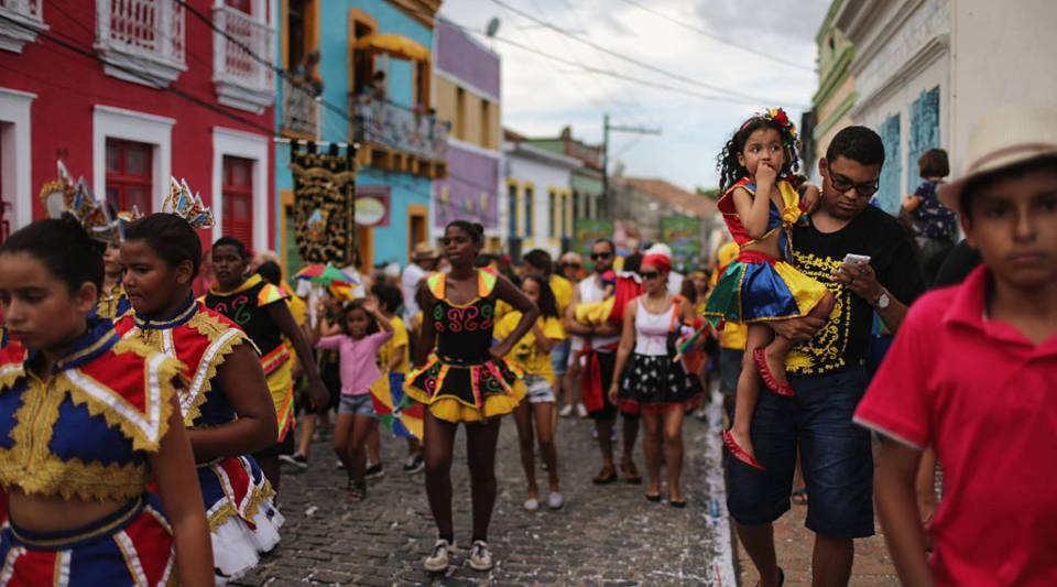 Revellers march during pre-Carnival celebrations on January 30, 2016 in Recife, Pernambuco state, Brazil. Health officials believe as many as 100,000 people have been exposed to the Zika virus in Recife, although most never develop symptoms. Carnival celebrations are scaled down, but continuing normally as planned.