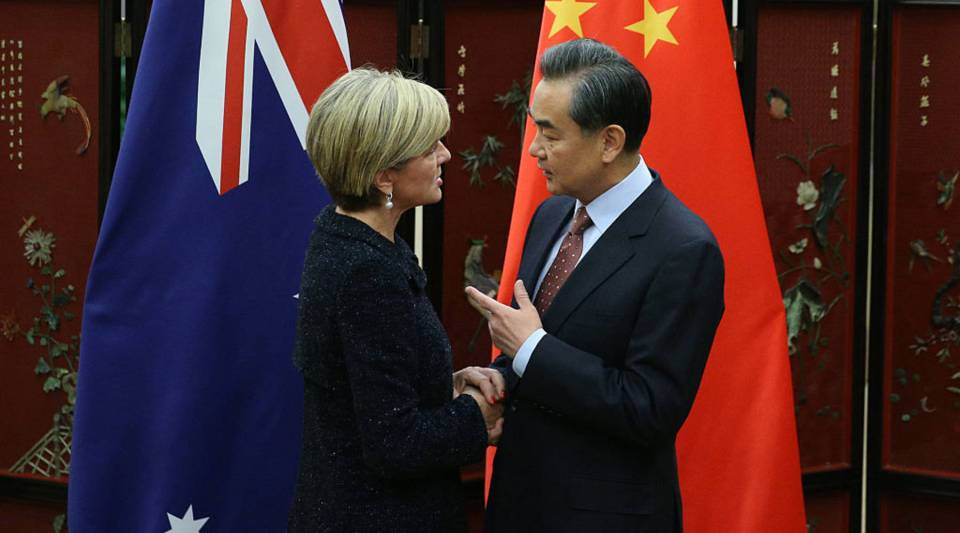 Australian Foreign Minister Julie Bishop (L) shakes hands with Chinese Foreign Minister Wang Yi as she arrives for a meeting at the Ministry of Foreign Affairs on February 17, 2016 in Beijing, China. Bishop is visiting China to discuss the concerns surrounding the militarization of islands in the South-China Sea.