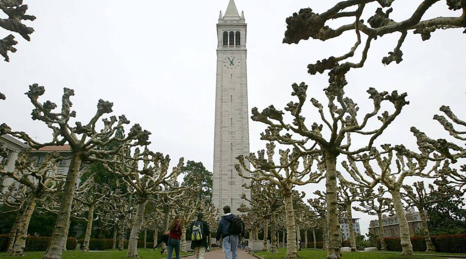 Students walk near Sather Tower on the University of California at Berkeley campus February 24, 2005 in Berkeley, California.