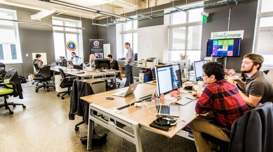 New tech companies at the RocketSpace co-working office use the gig economy to outsource jobs.