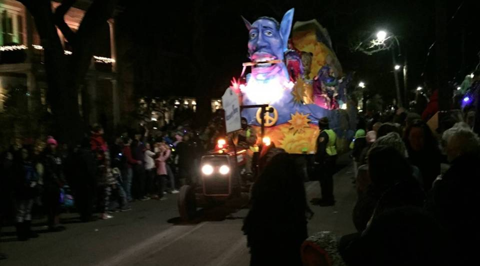 A float in the New Orleans Muses parade makes its way up New Orleans' St. Charles Avenue