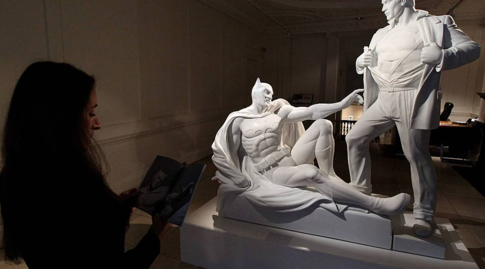 Artist Mauro Perucchetti's sculpture 'Modern Heroes', which depicts Batman and Superman in a pose reminiscent of The Creation of Adam in The Sistine Chapel, is installed in the Halcyon Gallery on October 6, 2010 in London, England.