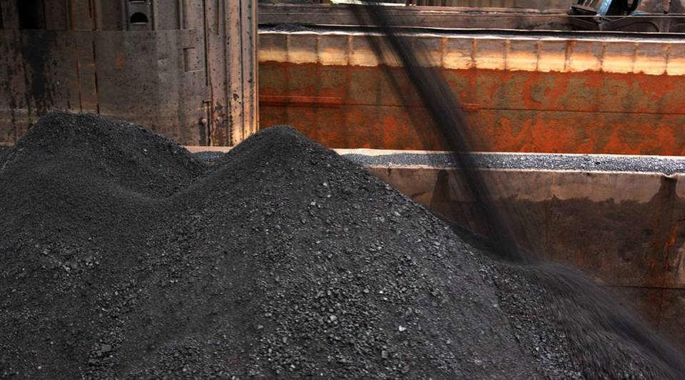 Coal is poured into a barge that will be moved to a steel plant in western Pennsylvania.