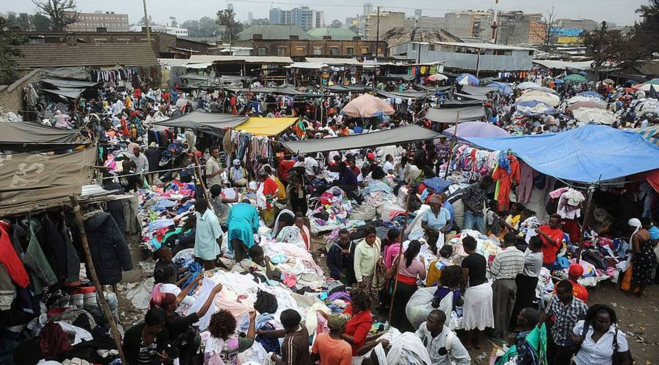 People walk around Gikomba Market, East Africa's biggest second-hand clothing market, in Nairobi.